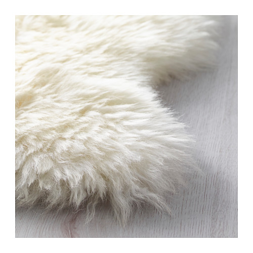 Ask emeline how to make a basement bedroom cozy the for Lambskin rug ikea